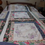 2016 The needlepoint squares were a gift and I made a king size quilt