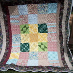 My grandmother did the center squares and I made this for my mom